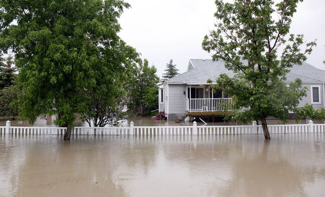 A property sits underwater in High River, Alta.