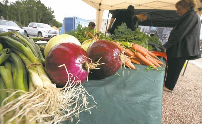 Under pending legislation, only producers who've been organically certified will be able to promote their veggies as organic at farmers markets such as this one on Main Street.