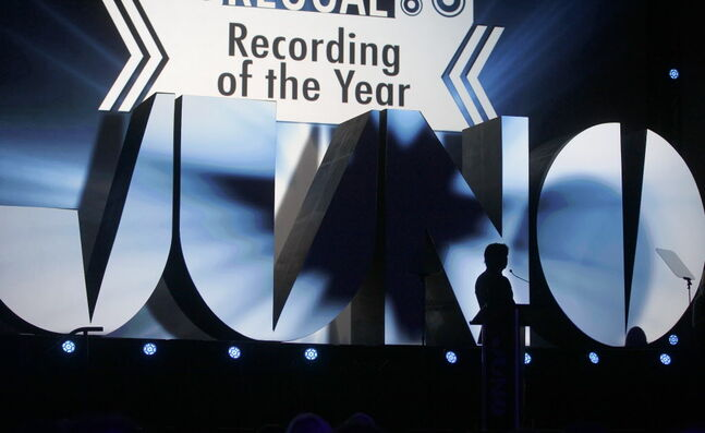 Host Jian Ghomeshi silhouetted prior to presenting Best Reggae Recording.
