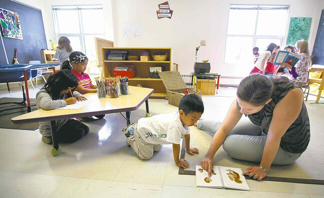 A kindergarten class in Winnipeg Tuesday. The Winnipeg School Division will begin debating a motion next month to start full-time kindergarten and nursery classes a year from now, and have it fully rolled out by 2018.