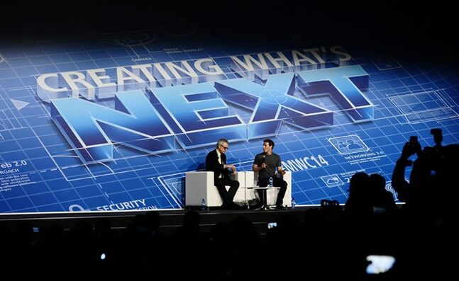 Mark Zuckerberg Chairman and CEO of Facebook, centre right, speaks during a conference at the Mobile World Congress, the world's largest mobile phone trade show in Barcelona, Spain, Monday, Feb. 24, 2014. Expected highlights include major product launches from Samsung and other phone makers, along with a keynote address by Facebook founder and chief executive Mark Zuckerberg. (AP Photo/Manu Fernandez)