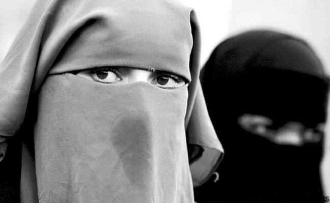 FILE - In this Nov. 30, 2006 file photo, unidentified women are seen wearing a niqab during a demonstration outside the Dutch parliament in The Hague, Netherlands. The Belgian parliament is likely to vote Thursday, April 29, 2010 on whether to ban face coverings worn by observant Muslim women. If passed, the ban would make Belgium the first country in Europe to outlaw the face coverings, which include both niqabs and burqas. (AP Photo/ Fred Ernst, File)