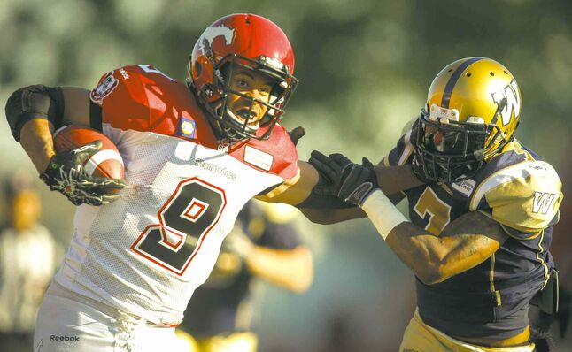Stampeders' running back Jon Cornish ran roughshod over the Bombers defence Saturday, including this straight-arm escape of Demond Washington.