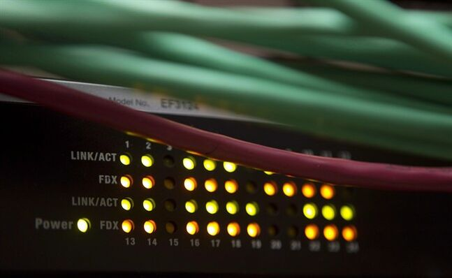 Lights on an internet switch are lit up in an office in Ottawa, on February 10, 2011. THE CANADIAN PRESS/Adrian Wyld