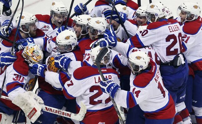 Edmonton Oil Kings Curtis Lazar (bottom centre) celebrates scoring the winning goal against the Val-d'Or Foreurs in semifinal action of the Memorial Cup CHL hockey tournament, in London, Ont. on Friday, May 23, 2014. THE CANADIAN PRESS/Dave Chidley