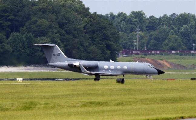 A plane taxies after arriving at Dobbins Air Reserve Base in Marietta., Ga., Saturday, Aug. 2, 2014. Officials at Emory University Hospital in Atlanta expect an American who is infected with the Ebola virus to be transported for treatment today. (AP Photo/John Bazemore)