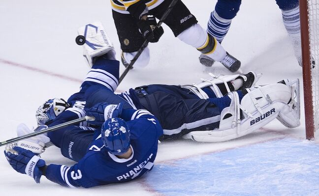 Toronto Maple Leafs goalie James Reimer makes a blocker save as Maple Leafs defenceman Dion Phaneuf looks on during the third period of Wednesday night's game against the Boston Bruins in Toronto.