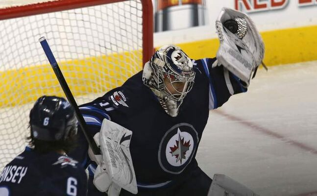 Winnipeg Jets' goaltender Ondrej Pavelec flashes the leather against the Carolina Hurricanes.