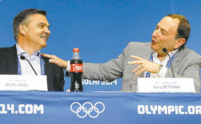 NHL commissioner Gary Bettman (right) and IIHF president Rene Fasel spar at a news conference in Sochi Tuesday. Olympic gold is 'almost as good' as a Stanley Cup win, Bettman jabbed.