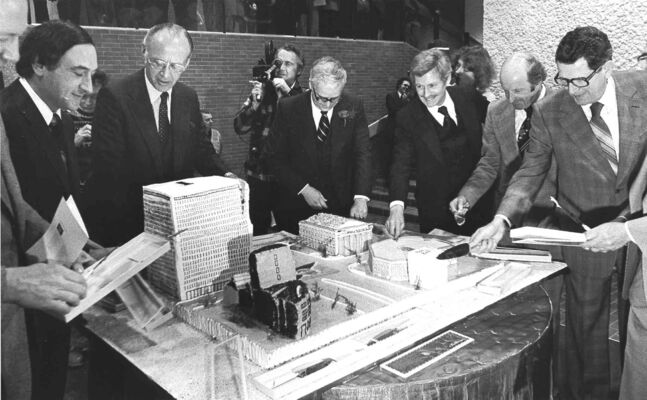 Business leaders and politicians share cakes that were fashioned after buildings at Portage and Main during celebrations to mark the opening of the underground concourse in 1979.