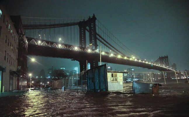 Streets are flooded under the Manhattan Bridge in the Dumbo section of Brooklyn, N.Y. (AP Photo/Bebeto Matthews)