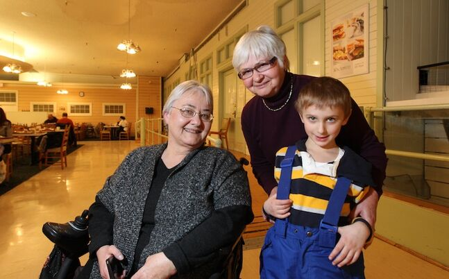 Five-year-old Lucien Guertin poses with his grandmother Margaret Wilcok (standing) and her sister Clare Simpson Wednesday after having lunch.
