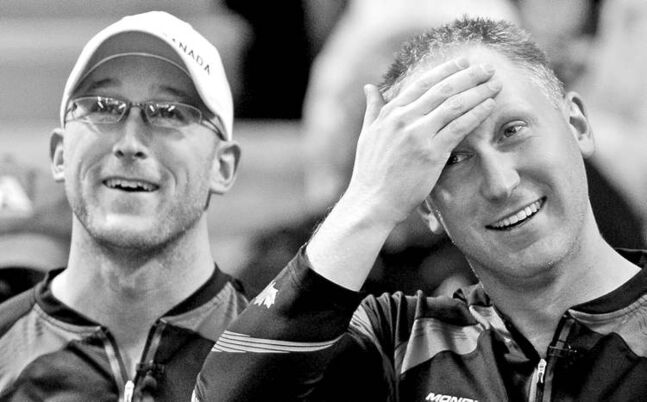 Jonathan Hayward / The Canadian PressPhew! Canada skip Brad Jacobs (right) and lead Ryan Harnden were down 4-1 to Finland early but came back to win 8-6 at the world curling championship in B.C.