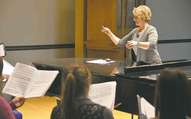Canadian Mennonite University's Janet Brenneman rehearses with the alumni choir.