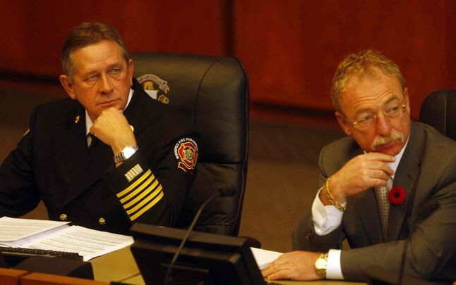 CAO Phil Sheegl (right) formally resigned, and fire-paramedic chief Reid Douglas (left) was fired, shortly before a forensic audit of the fire hall replacement program was released.