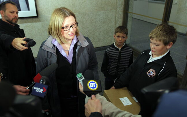 Paula Havixbeck, with her sons Nick and Adrian, registered Wednesday for her mayoral run.