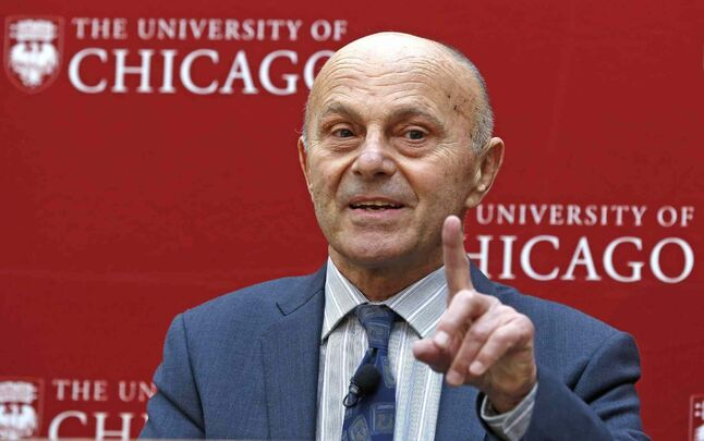 Nobel Prize winner Eugene Fama, 74, of the University of Chicago, speaks at a news conference Monday, in Chicago, after being named one of three winners of the Nobel Prize for Economics. He shares the prize with Lars Peter Hansen, 60, of the University of Chicago, and Robert Shiller, 67, of Yale University.