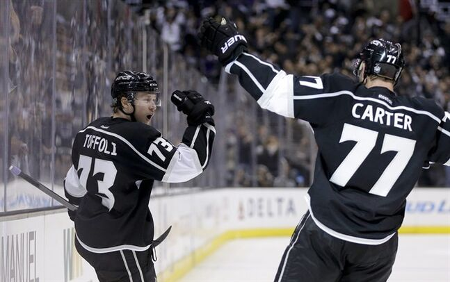 Los Angeles Kings center Tyler Toffoli, left, celebrates his goal with teammate Jeff Carter against the Chicago Blackhawks during the second period of Game 3 of the Western Conference finals of the NHL hockey Stanley Cup playoffs in Los Angeles, Saturday, May 24, 2014. (AP Photo/Chris Carlson)