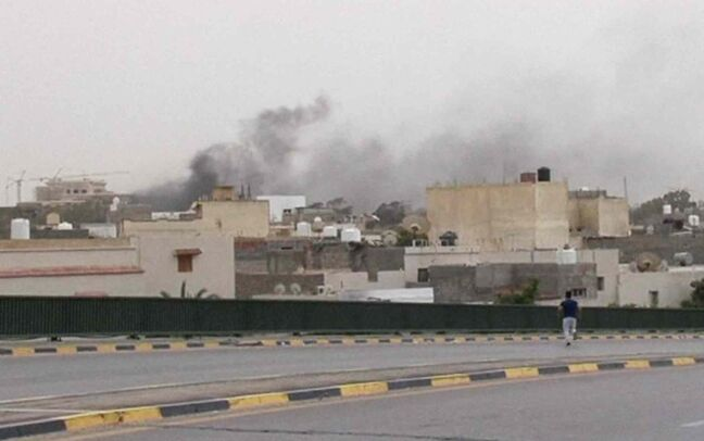 In this image made from video provided by the Libyan national army via AP Television, smoke rises over the parliament area after troops of Gen. Khalifa Hifter targeted Islamist lawmakers and officials at the parliament in Tripoli, Libya, Sunday, May 18, 2014. Forces loyal to a rogue Libyan general attacked the country's parliament Sunday, expanding his eastern offensive against Islamists into the heart of the country's capital.