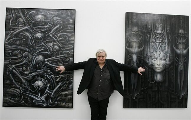 FILE - In this June 29, 2007 file picture Swiss artist H.R. Giger poses with two of his works at the art museum in Chur, Switzerland. H.R. Giger, who designed the creature in Ridley Scott's sci-fi horror classic