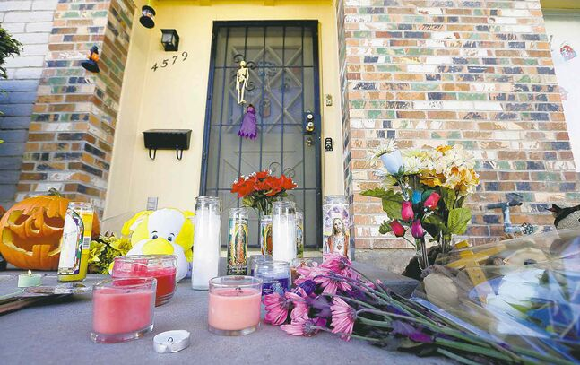 A makeshift memorial was set up outside a Phoenix home Monday after four family members were fatally shot this weekend. Police say a neighbour was the gunman.
