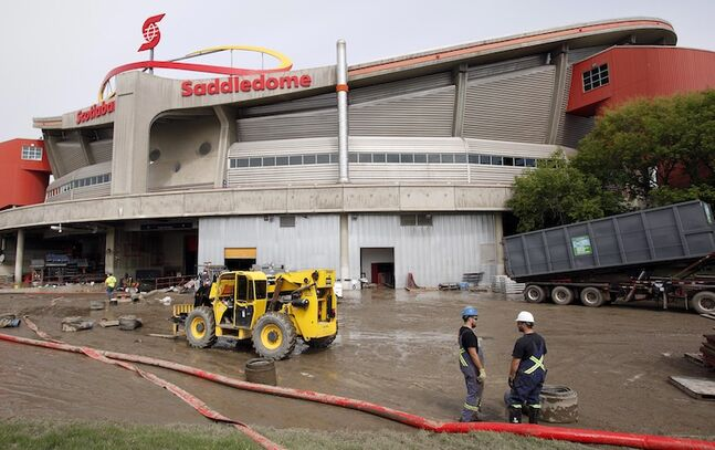 Clean-up crews work outside the Saddledome Monday.