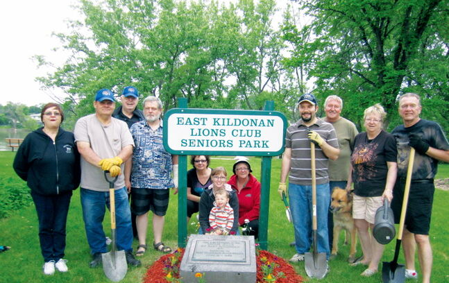 Members of the Lions Club of East Kildonan pose after a clean-up at the East Kildonan Lions Club Seniors Park on June 9.