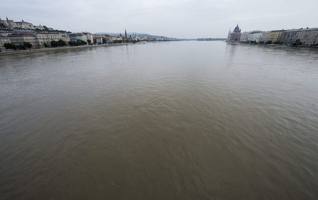 The swollen Danube river is seen from the Chain bridge in Budapest, Hungary. The Parliament building is on the right.