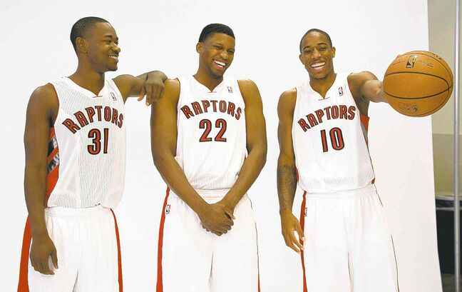Toronto Raptors player (from left) Terrence Ross, Rudy Gay and DeMar DeRozan pose for photos after it was announced Toronto will host the 2016 NBA all-star game.
