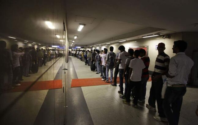 Commuters wait in line at a Metro station after Delhi Metro rail services were disrupted following power outage in New Delhi, India, Tuesday, July 31, 2012. India's energy crisis cascaded over half the country Tuesday when three of its regional grids collapsed, leaving more than 600 million people without government-supplied electricity in one of the world's biggest-ever blackouts. The city's Metro rail system, which serves about 1.8 million people a day, immediately shut down for the second day in a row. (AP Photo/ Manish Swarup)