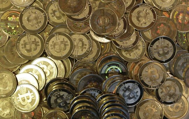 This April 3, 2013 photo shows bitcoin tokens in Sandy, Utah. THE CANADIAN PRESS/AP, Rick Bowmer