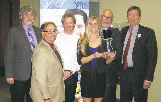 Fish Winnipeg committee members Rick Koss, Stephen Yuffe, Rob Cann, Katherine Ward, John Toone and Don Lamont accept a Volunteer Service Award for the organization's efforts over the past 16 years to provide urban youth the opportunity to fish.
