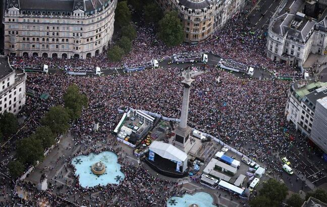 Floats carrying British Olympic and Paralympic athletes take part in a parade as seen from the air as they pass Trafalgar Square. Thousands of people waving British flags lined the streets of London on Monday to toast the athletes behind the country's unprecedented summer of sporting success. (AP Photo/Peter Macdiarmid, Pool)