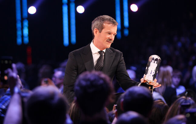 Commander Chris Hadfield presents BTO with their Canadian Music Hall of Fame induction trophy.