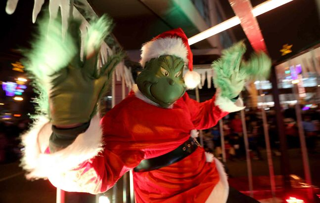 The Winnipeg Police Service float featured the Grinch, who was safely behind bars during the parade.