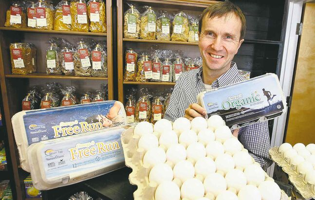Hermann Grauer, of Nature's Farm in Steinbach, with some of the company's products. The organic food industry is worth $3.5 billion in Canada.    Ken Gigliotti / Winnipeg Free Press