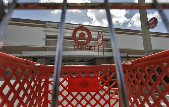 FILE - This Monday, Aug. 19, 2013 file photo shows a shopping cart outside a Target store in Riverview, Fla. Target Corp. reports quarterly earnings on Wednesday, Aug. 20, 2014. (AP Photo/Chris O'Meara, File)