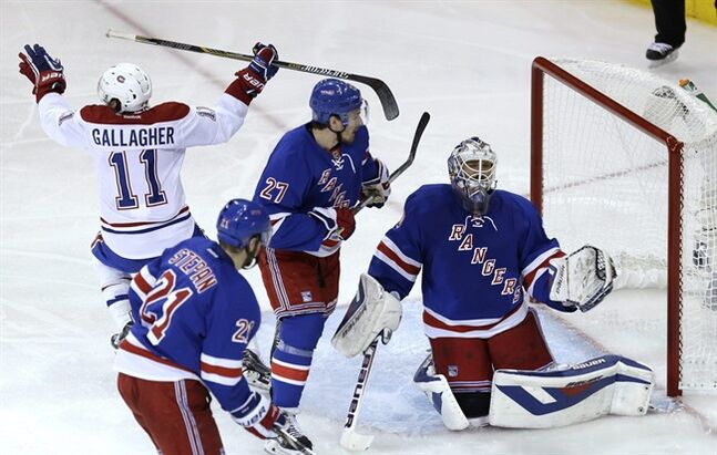 New York Rangers goalie Henrik Lundqvist, right, reacts after being scored on by Montreal Canadiens' Andrei Markov during the second period of Game 3 of the NHL hockey Stanley Cup playoffs Eastern Conference finals, Thursday, May 22, 2014, in New York. (AP Photo/Seth Wenig)