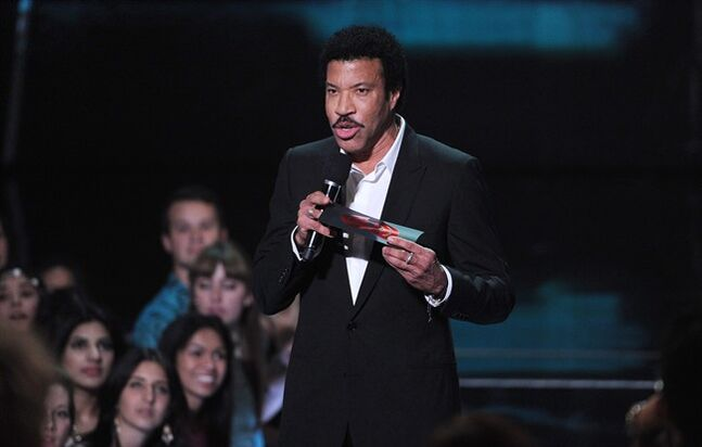 Lionel Richie speaks on stage at the iHeartRadio Music Awards at the Shrine Auditorium on Thursday, May 1, 2014, in Los Angeles. Thirty years after