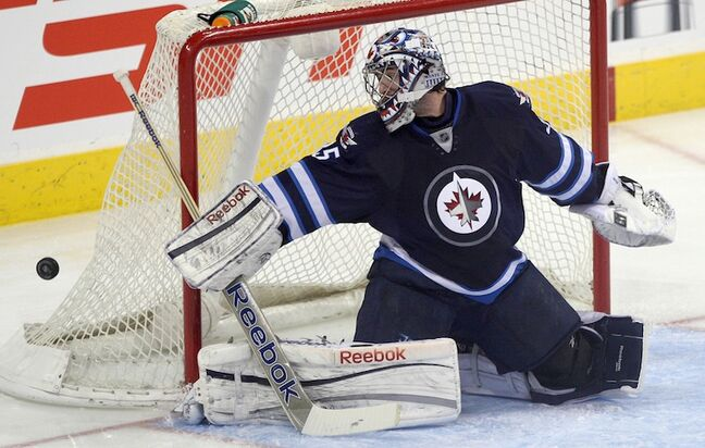 Winnipeg Jets goalie Al Montoya watches the puck go wide of the net during the third period. Montoya replaced Ondrej Pavelec after the Jets' starting goalie let in three goals on nine shots.