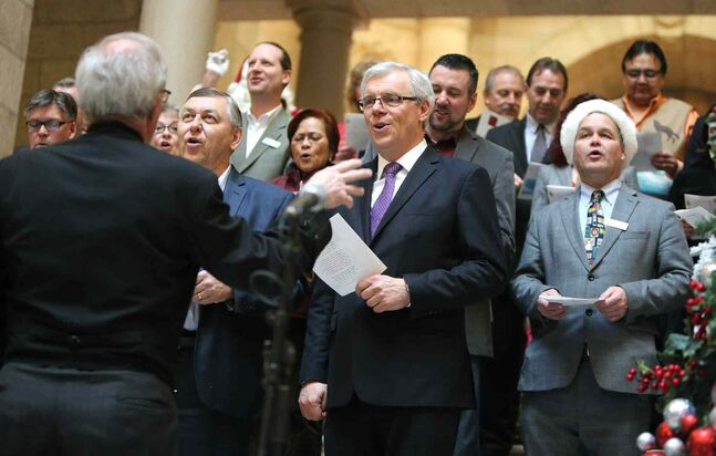 A choir made up of MLAs and Premier Greg Selinger and led by Speaker Daryl Reid entertains visitors at the Legislative Open House at the Manitoba Legislature on Saturday.