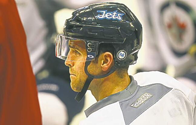 Jet's Captain Andrew Ladd takes in the coaches commentary at a team workout Friday. See story. 2013 - (Phil Hossack / Winnipeg Free Press)