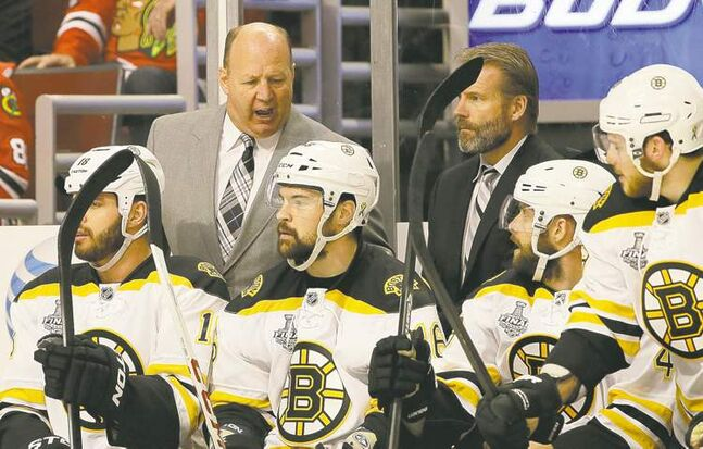 Boston Bruins head coach Claude Julien barks orders to his bench in Game 1 of the Stanley Cup final in Chicago. At least one player seems to be paying attention.