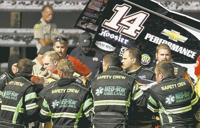 Tony Stewart, third from left, is loaded into an ambulance in Iowa.
