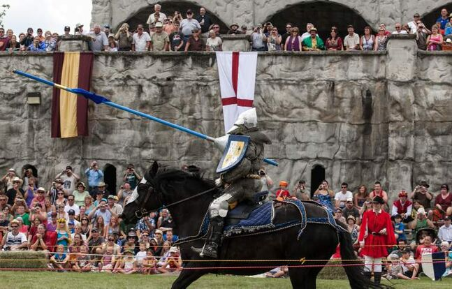 Jordan Heron, from Niagara-on-the-Lake, Ontario, passes the crowd during a joust competition at the 2012 Medieval Festival at the Immaculate Conception Church and Grotto on Saturday in Cooks Creek.