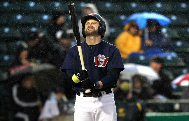 Winnipeg Goldeyes' Josh Mazzola's expression says it all in the pouring rain at Shaw Park Thursday night. The game was delayed because of the rain, but the Goldeyes ultimately fell to the Lincoln Saltdogs.