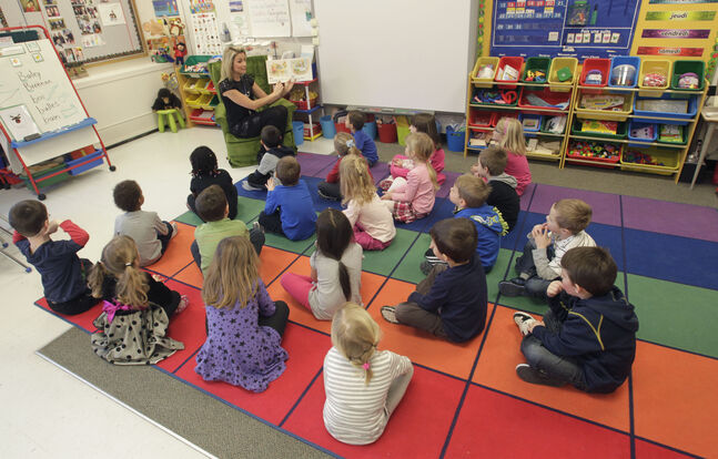 Kindergarten teacher Jenna Derouard reads to her class at Ecole Robert Browning.