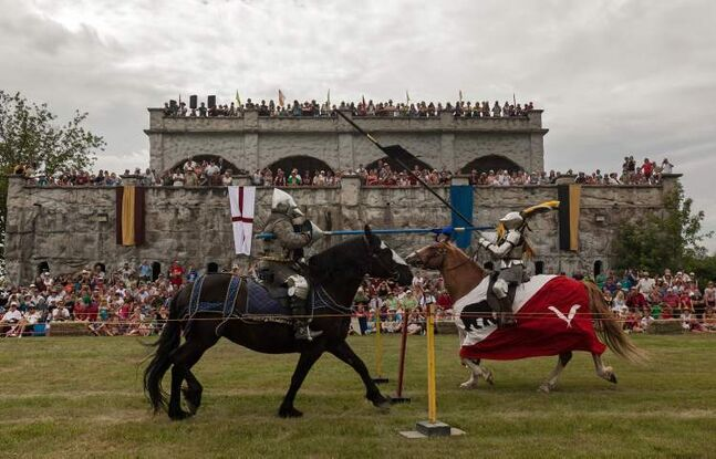 Jordan Heron, from Niagara-on-the-Lake, Ontario, (left) lands a hit against Alison Mercer, of Calgary, during a joust competition at the 2012 Medieval Festival at the Immaculate Conception Church and Grotto on Saturday in Cooks Creek.