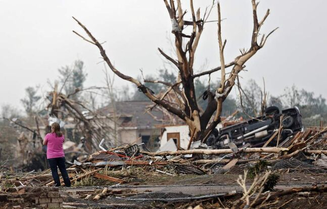 A resident surveys the damage after the tornado hit the area near 149th and Drexel on Monday in Oklahoma City, Okla.