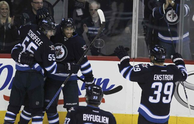 Winnipeg Jets' Evander Kane (9) and Mark Sheifele (55) celebrate after a third-period goal.